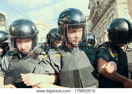 MOSCOW - MAY 31, 2011: Riot police officers during protests to support the 31st article of the Russian Constitution that gives the right to peaceful assemblies.