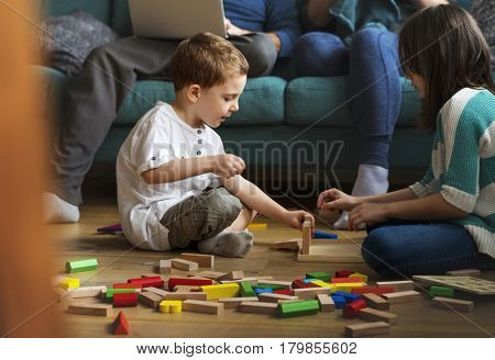 Little Boy Playing Toy Blocks
