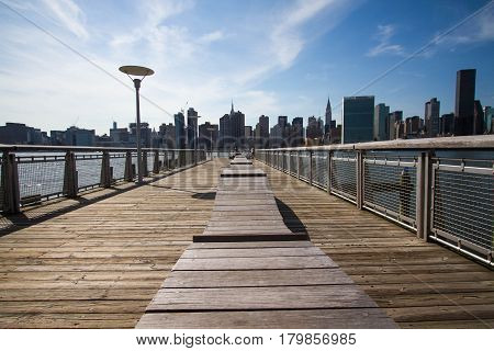 The pier at Gantry Plaza State Park and buildings in Manhattan, New York