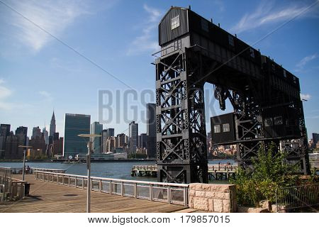 Gantry Plaza State Park and buildings in Manhattan with blue sky, New York