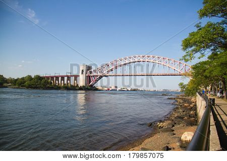 The Hell Gate Bridge and the shore at Astoria Park, New York