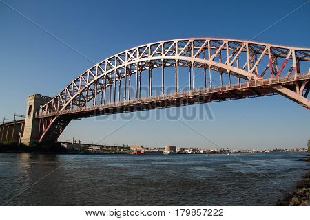 The Hell Gate Bridge over the river, Astoria, New York