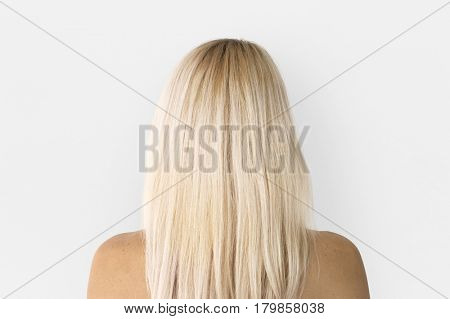 Woman standing and posing for photoshoot back view