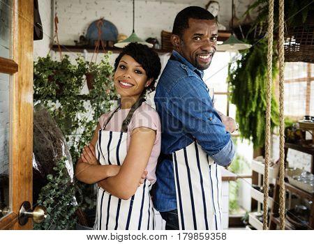 African Descent Owner Couple Stand Inside Flower Shop