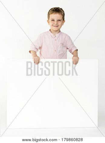 Boy hold a placard in a shoot