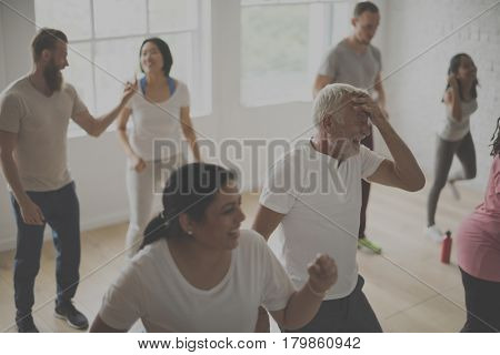 Active people exercising together indoor