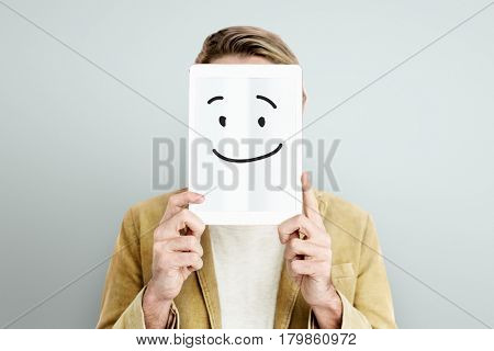 Smiling face on a device screen