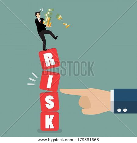 Businessman standing on shaky risk blocks by hand of enemy. Investment risk concept