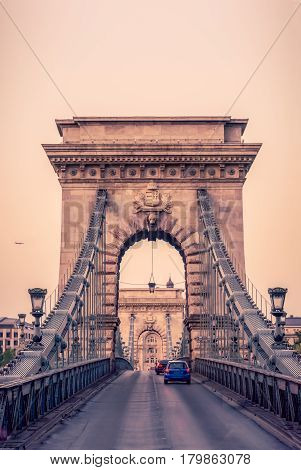 Cars Drive Over The Historic Chain Bridge In Budapest
