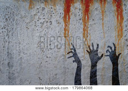 Zombie hands silhouette in shadow on concrete wall and blood background with space for text or image. Zombie theme with corpse hands on cemetery.