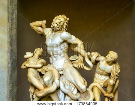 Ancient statue of Laocoon and his Sons in Vatican, Italy. The Trojan Laocoon was strangled by sea snakes with his two sons poster