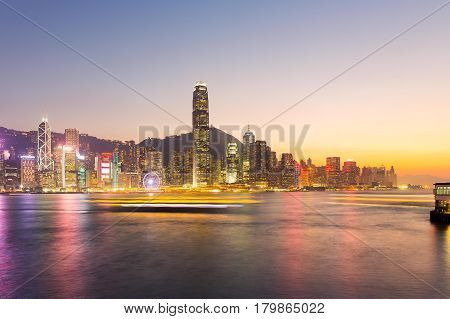 Cityscape and skyline at victoria harbour in hong kong city at twilight time.