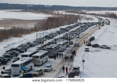 Kazan, Russia - 28 february 2017 - Sviyazhsk Island - Parking with snow covered cars - carnival celebration, wide angle