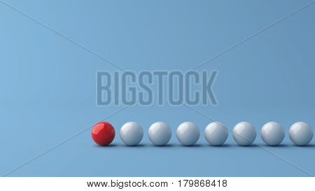 Leadership concept red leader ball standing out from the crowd of white balls on blue background. 3D rendering.