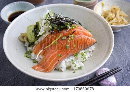 Traditional Japanese Hokkaidon Thinly sliced salmon Donburi as close-up in a bowl