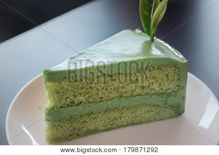 Japanese Matcha green tea sponge cake on a plate.