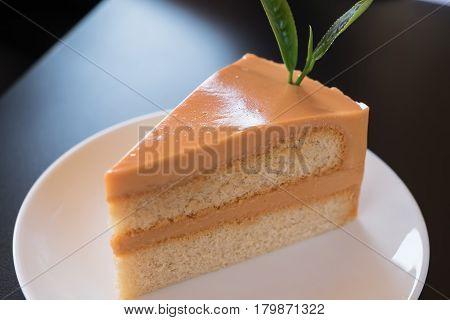iced tea cake on a  plate .