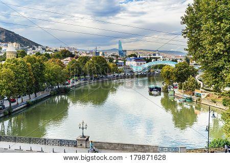 Tbilisi Georgia - September 22 2016: View of the Kura River with Bridge of Peace and Metekhi bridge