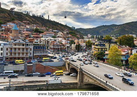 View Of Metekhi Bridge Through Kura River In Tbilisi, Georgia