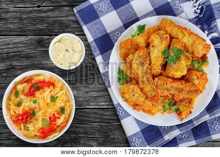 Fried Fish Fillets With Coleslaw And Sauce