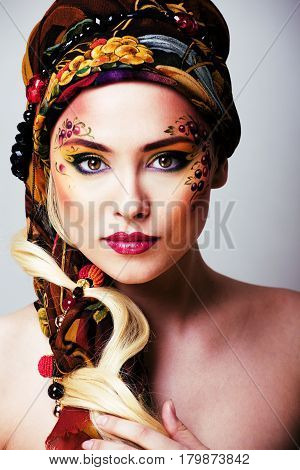 portrait of contemporary noblewoman with face art creative close up, russian style fashion