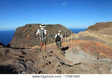 Man and woman hiking in mountain