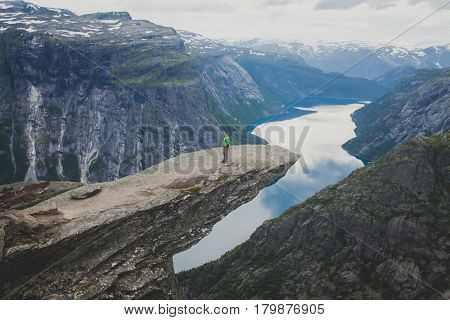 Beautiful summer vibrant view on famous Norwegian tourist place - trolltunga, the trolls tongue with a lake and mountains, Norway, Odda.
