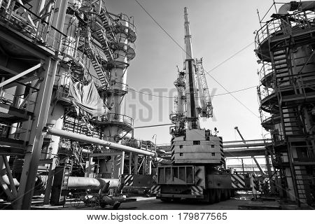 Repair Work At The Refinery By A Crane