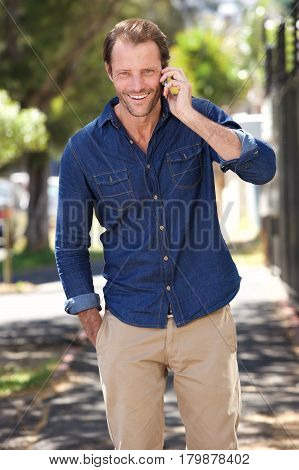 Cool Guy Walking And Talking With Mobile Phone
