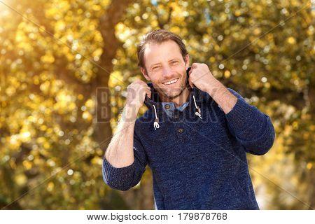 Happy Older Guy Standing Outside In Autumn Season