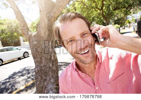 Close Up Happy Older Man Standing Outdoors With Mobile Phone