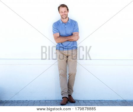 Full Body Handsome Older Man Smiling Against White Wall