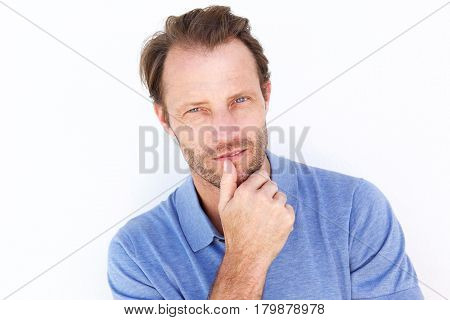 Close Up Older Man Thinking With Hand On Chin
