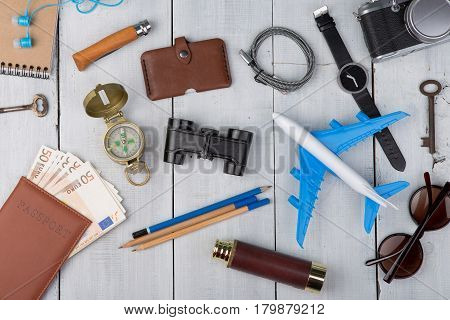 Plane, Passport, Money, Camera, Watch, Compass, Sunglasses, Headphones, Binoculars, Note Pad, Keys,