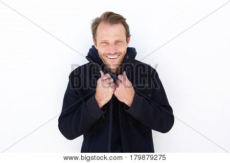 Smiling Man Keeping Warm With Jacket