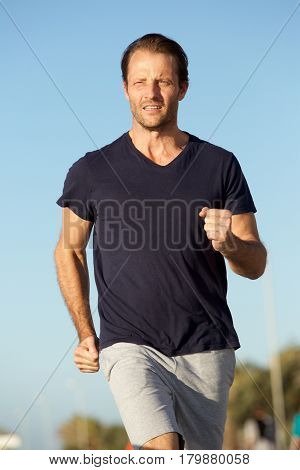 Healthy Active Man Running Outside