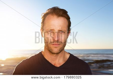 Middle Age Man Standing Outside Staring