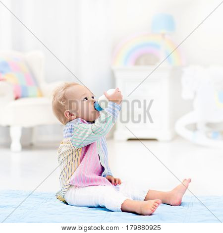 Baby Boy With Bottle Drinking Milk Or Formula