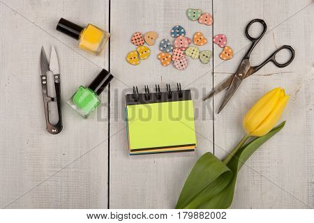 Flower Tulip, Blank Note Pad, Scissors, Nail Polish And Buttons In The Shape Of Hearts