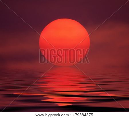 rising of the red sun over water