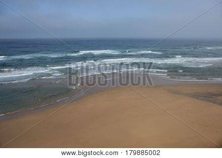 Deserted sandy beach of Morocco Atlantic ocean coast