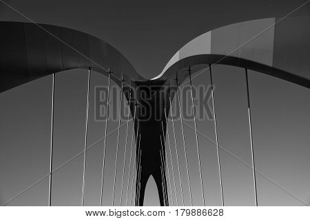 MILAN, ITALY - OCTOBER 4, 2016: Milan (Lombardy Italy): modern bridge for pedestrians and bicycles in the Portello area. Black and white