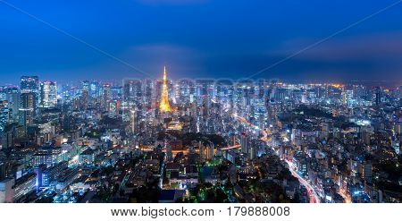 Panorama view over Tokyo tower and Tokyo cityscape view from Roppongi Hills at night in TokyoJapan
