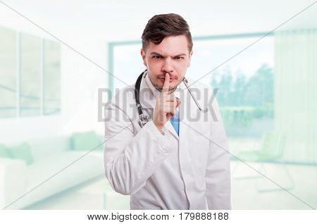Serious Male Doctor Indicate To Keep Silence