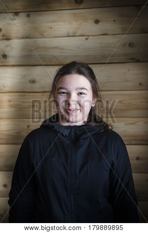 Portrait of a happy teenager girl in a black jacket
