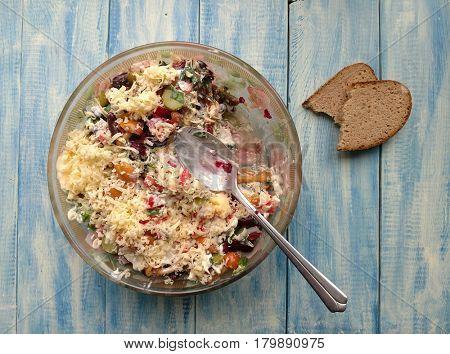 Salad with mushrooms, boiled potatoes, ham, onions and mayonnaise