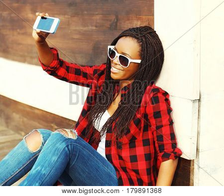 Fashion Pretty Smiling African Woman Is Taking Picture Self Portrait On Smartphone Having Fun In The