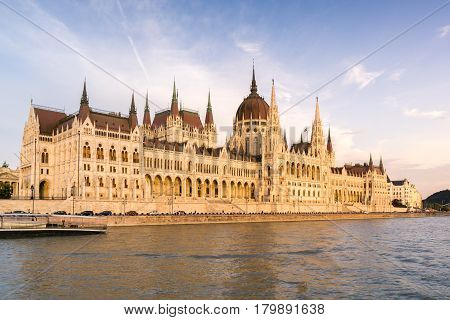 View of the architecturally gothic Hungarian Parliament building as seen from a boat on the Danube River.