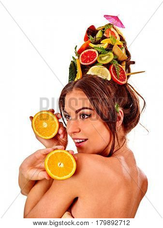Hair mask from fresh fruits on woman head. Girl with hairstyle and bare back hold halves of orange for organic skin and body therapy. Concept of healthy and beauty on isolated.