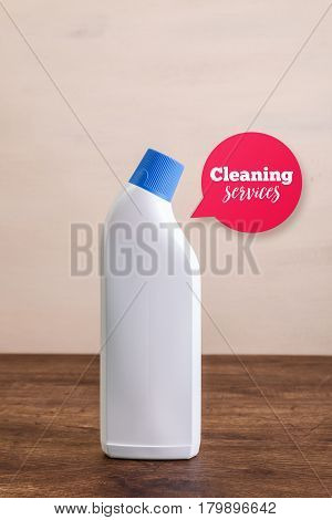 Mock-up plastic bottles. Cleaning services speech bubble. Mockup design for branding. Washing wc cleaner. Front view. Wooden rustic board.